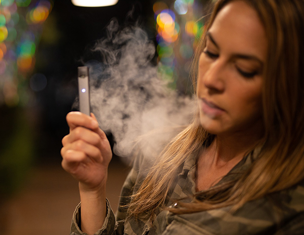 woman vaping with JUUL