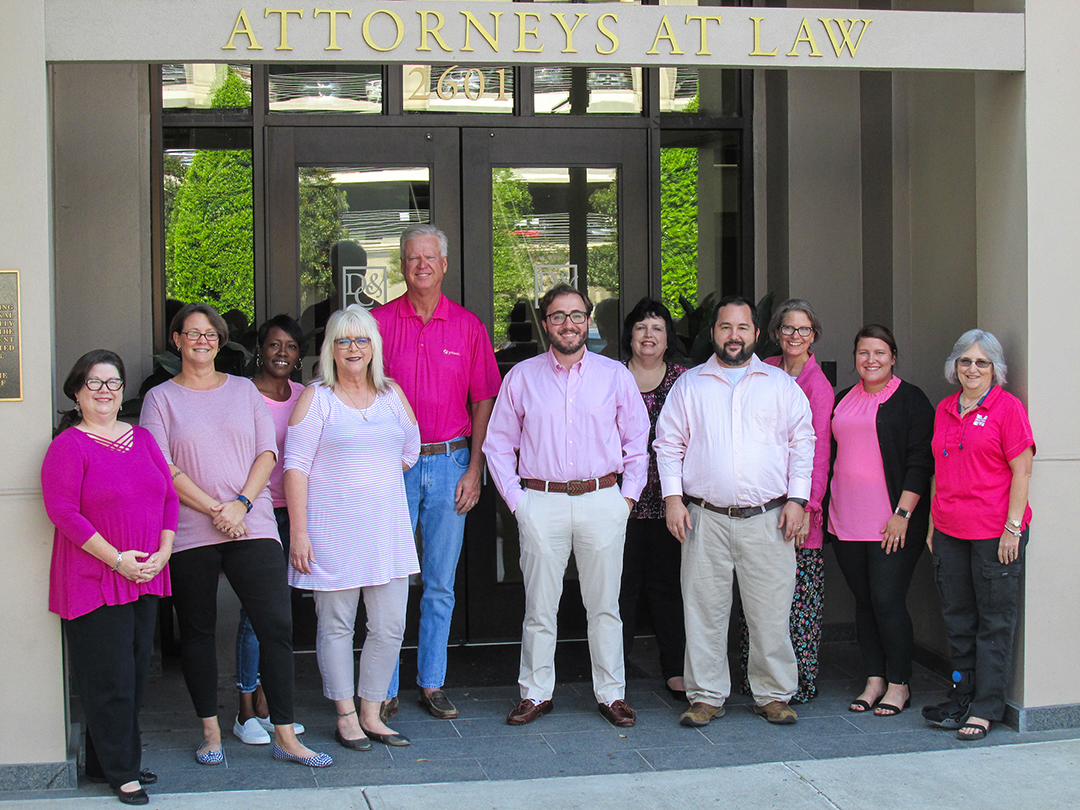 The Davis & Crump Law team posing in pink!